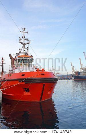 Red Tugboat Industrial Vessel Moored in Port