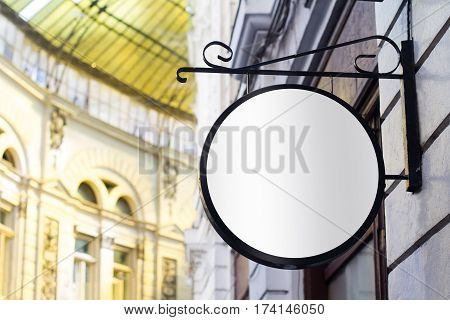 Horizontal front view of empty round signage on a building with classical architecture
