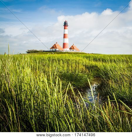 Beautiful View Of Landscape With Small Pond And Lighthouse In The Background At North Sea In Nordfri