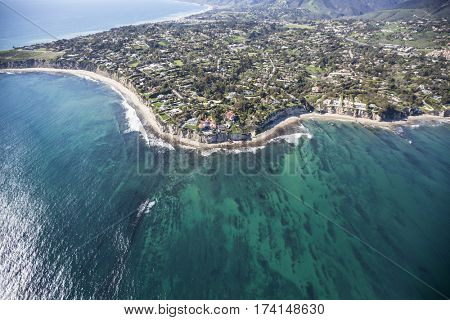 Aerial view of Point Dume and clear Pacific Ocean water in scenic Malibu near Los Angeles in Southern California.