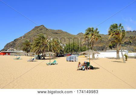 Playa De Las Teresitas beach Tenerife Canary Islands Spain Europe - June 14 2016: Tourists on the beach enjoying the sun