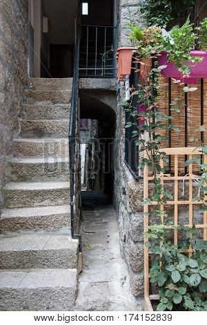 SARTENE, CORSICA, FRANCE, SEPTEMBER 03, 2016: Very narrow alleyway next to the staircase