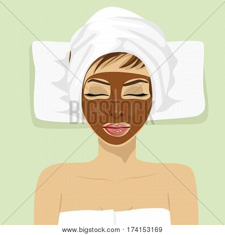 Chocolate facial mask. Chocolate therapy. Young woman with treatment mask on her face at a spa salon