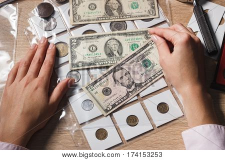 Hands With A Set Of Dollars In The Pockets