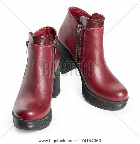 Pair Of Dark Red Womens Leather Boots Isolated On A White Background