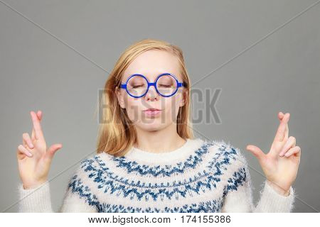 Teenage Blonde Woman Making Promise Gesture