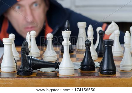 black and white figures on a chess-board