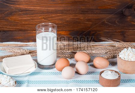 Natural Homemade Products: Milk, Cheese, Sour Cream, Butter And Eggs On Old Wooden Background With E