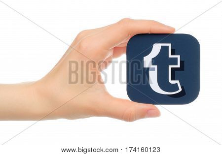 Kiev Ukraine - May 17 2016: Hand holds Tumblr icon printed on paper. Tumblr is a well-known social networking and news service