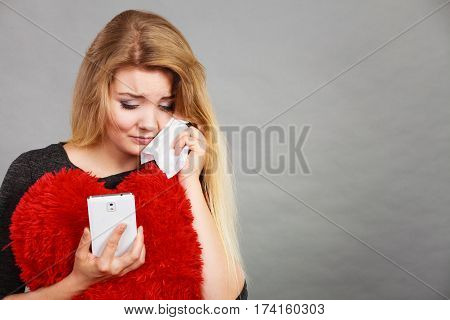 Sad Heartbroken Woman Looking At Her Phone