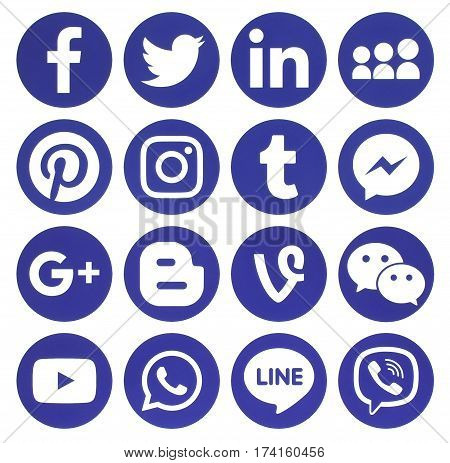 Kiev Ukraine - February 13 2017: Collection of popular blue round social media icons printed on paper: Facebook Twitter Google Plus Instagram Pinterest LinkedIn Blogger Tumblr and others