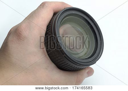 The hand holding the lens on a white background.