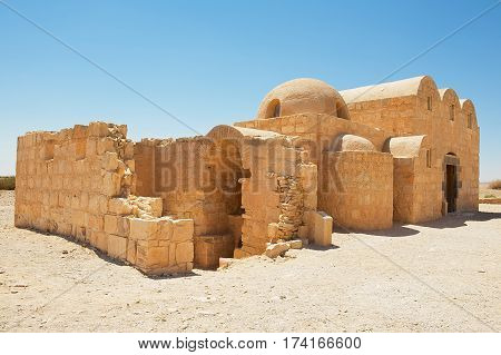 Exterior of the Amra desert castle (Qasr Amra) near Amman, Jordan. World Heritage built in 8th century by the Umayyad caliph Walid II and famous for it's unique frescos.