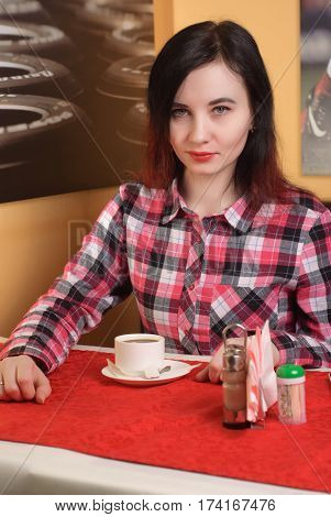 Girl In A Plaid Shirt Drinking Coffee,