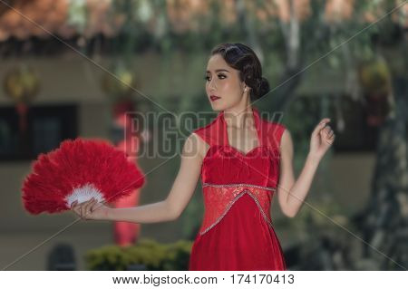 Asian woman with Chinese traditional dress cheongsam .Chinese new year concept.