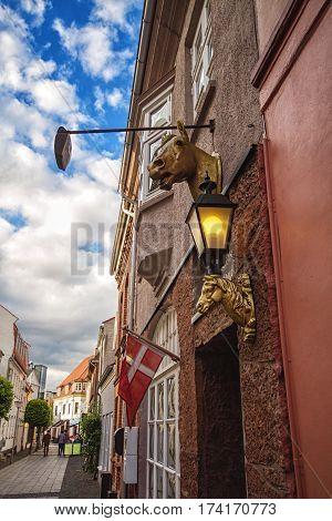 HORSENS DENMARK - JUNE 11: House with emblem of the city Horsens and flag of Danmark in 2012