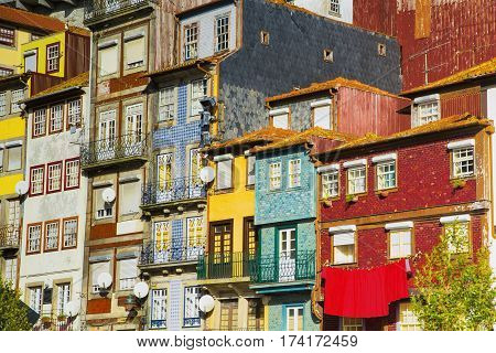 Traditional quaint houses in the old, vintage and touristic ribeira district of Porto, Portugal