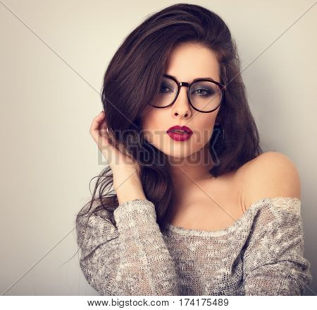 Beautiful Sexy Bright Red Lips Makeup Woman Posing In Gey Blouse On Blue Background. Closeup Toned V