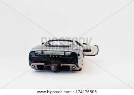 Hai, Ukraine - March 1, 2017: Mini Copy Of Green Toy Car Jaguar Xj 220 Isolated On White Background.