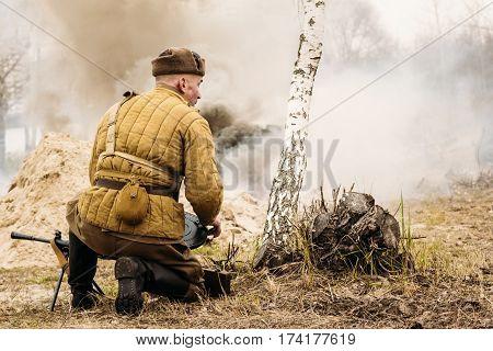 Soviet soldier gunner during a World War II staged fight