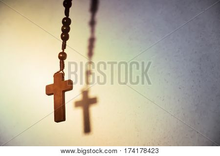 Holy Wooden Christian Cross. Copy space background