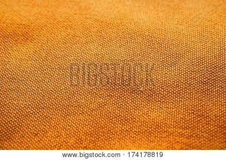 Orange fabric texture. Orange cloth background. Close up view of orange fabric texture and background. Abstract background and texture for designers. Orange texture.