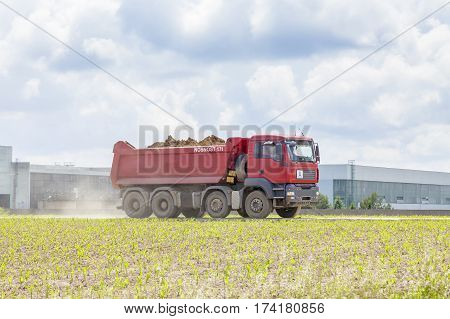 DUKOVANY, CZECH REPUBLIC MAY 28, 2014:Dump truck Tatra on green field