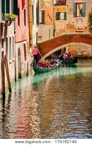 Italy, Venice - 24 May, 2015: Venice. A gondola ride along the canals of Venice. The most popular tourist attraction.