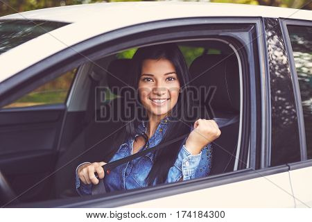 Closeup Portrait Of Young Woman Fasten Seat Belt In Her Car, Toned