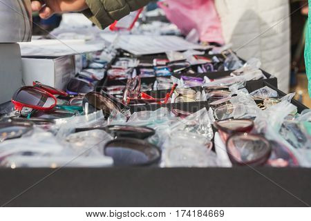 Illegal street dealers sell glasses, close up, horizontal