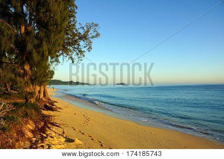 Waves lap on Waimanalo Beach at Dawn looking towards mokulua islands on Oahu Hawaii. January 2013.