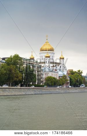 The landscape of the waterfront with a Church on the Moscow river.