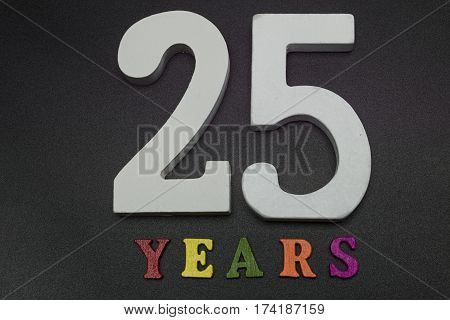 Twenty-five years in large white numerals on a black background.