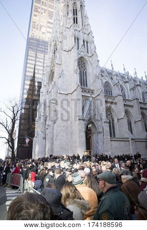 NEW YORK - JAN 13 2017: NYPD Det. Steven McDonald funeral procession and service at St Patricks Cathedral, 5th Avenue, Manhattan - Large crowd assembles at St Patricks Cathedral to pay respect.