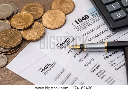 1040 Tax Form, Us Coins, Pen And Calculator
