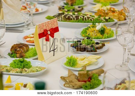 catering table set service with silverware and glass stemware at restaurant before party