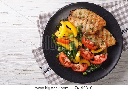Grilled Fish Steaks And Fresh Vegetable Salad Close-up. Horizontal Top View