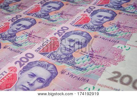 Pile of ukrainian money denomination of 200 UAH