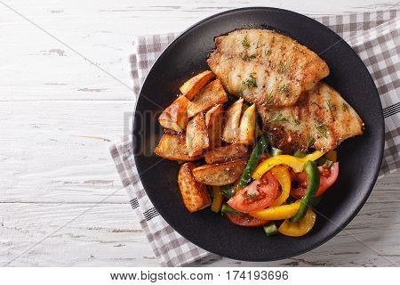 Grilled Tilapia Fillet And Potato Wedges, Fresh Salad Close-up. Horizontal Top View