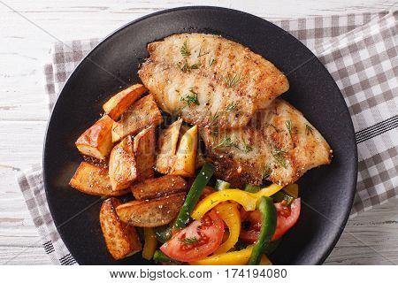 Grilled Tilapia Fillet, Fried Potatoes And A Vegetable Salad Close-up. Horizontal Top View