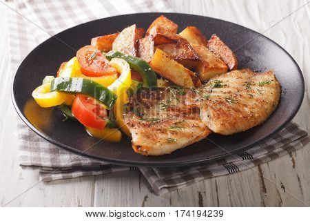 Grilled Tilapia Fillet, Fried Potatoes And A Vegetable Salad Close-up. Horizontal