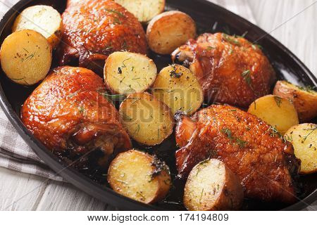 American Food: Maple Chicken Thighs And Baby Potatoes Close-up. Horizontal