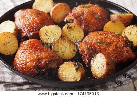 Maple Chicken Thighs And Baby Potatoes Close-up. Horizontal