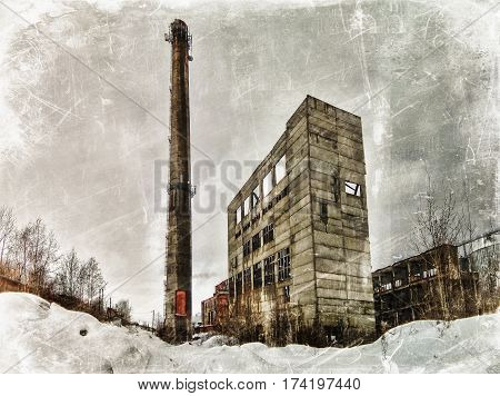 The old boiler and chimney on a background of the winter sky. Photos in a grunge style.