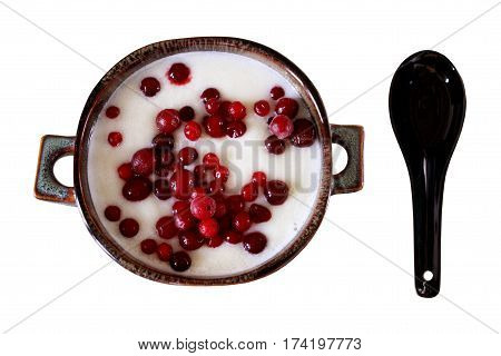 Top view of sweet semolina with berries for Breakfast. Porridge with cowberry in a ceramic bowl. Isolated on white. Horizontal location.