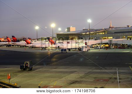 BOSTON - SEP. 26, 2015: Airplanes of Delta Air Lines at Boston Logan International Airport at sunrise, Boston, Massachusetts, USA.