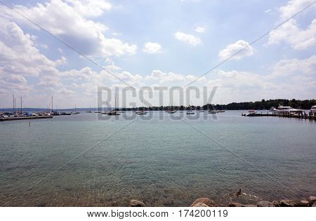 HARBOR SPRINGS, MICHIGAN / UNITED STATES - AUGUST 4, 2016: Boats are moored in the Harbor Springs Yacht Basin.