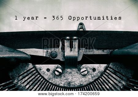 1 Year = 365 Opportunities Words Typed On A Vintage Typewriter In Black And White.