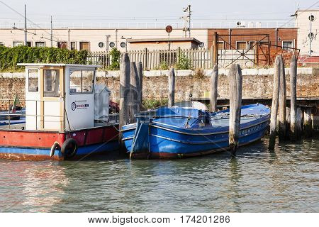 VENICE ITALY - June 30 2016: Colorful old boats on one of Venice Canals Venice Italy June 30 2016