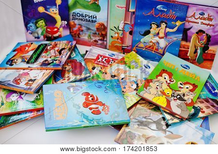 Hai, Ukraine - February 28, 2017: Differebt Animated Disney Movies Cartoon Production Books On White